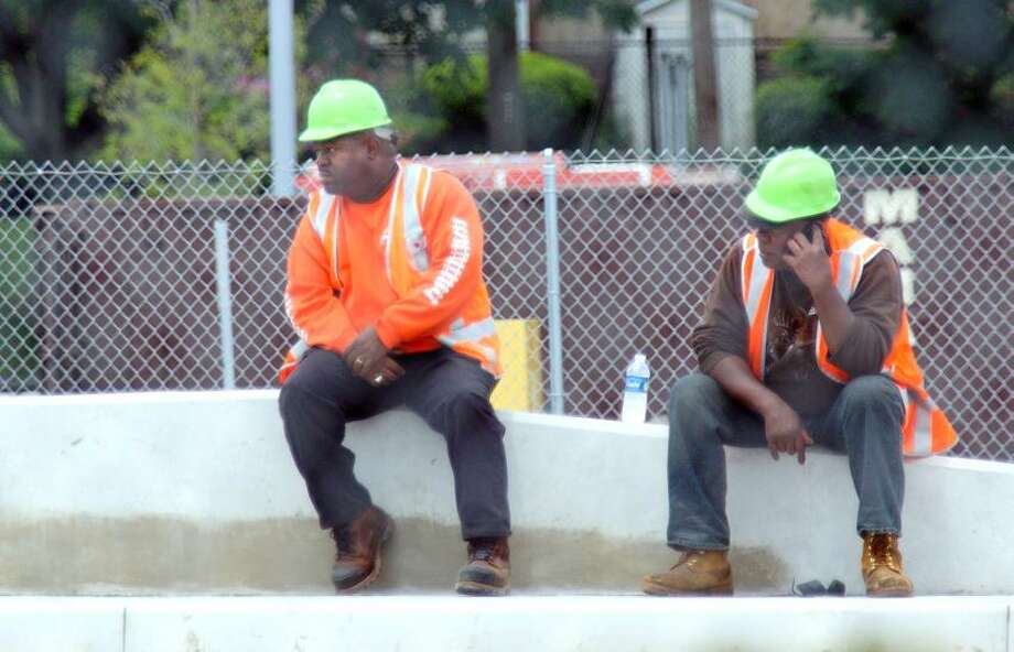 """West Haven--Metro North workers at the West Haven train station, where a worker was killed by a Metro North train, while working on the tracks.   Photo-Peter Casolino/Register <a href=""""mailto:pcasolino@newhavenregister.com"""">pcasolino@newhavenregister.com</a>"""