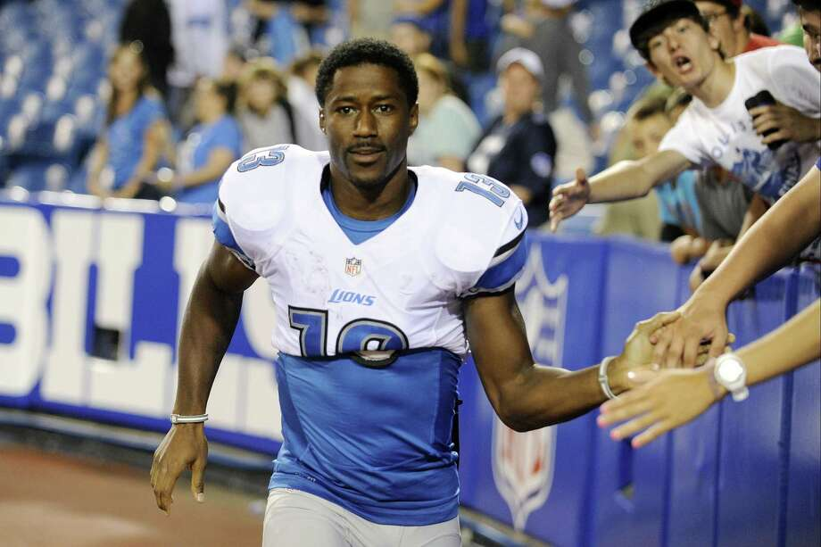 FILE - In this Aug. 29, 2013 file photo, Detroit Lions wide receiver Nate Burleson (13) walks away from fans after signing autographs after an NFL football game against the Buffalo Bills in Orchard Park, N.Y. The Detroit Lions say Burleson was in a one-car accident and needs surgery on a broken arm. The team said in a statement Tuesday morning, Sept. 24, 2013, that the police have confirmed alcohol was not involved. Photo: Associated Press / FR170498 AP