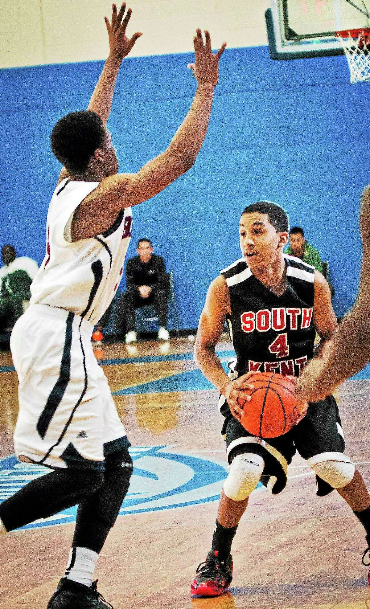 South Kent School's Tremont Waters looks to pass around a defender during Sunday's game against Brewster Academy.