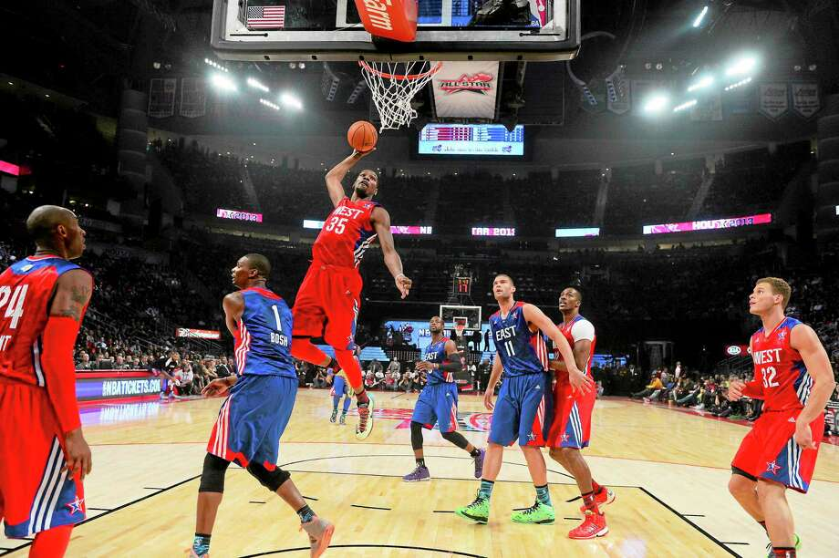 The Oklahoma City Thunder's Kevin Durant goes up for a shot during the first half of the NBA All-Star Game on Feb. 17 in Houston. Photo: Bob Donnan — The Associated Press   / AP2013