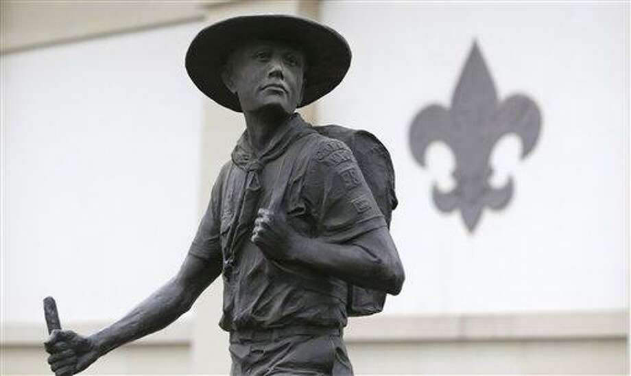 A statue of a Boy Scout stands in front of the National Scouting Museum, Monday, Jan. 28, 2013, in Irving, Texas. The Boy Scouts of America announced it is considering a dramatic retreat from its controversial policy of excluding gays as leaders and youth members. (AP Photo/LM Otero) Photo: AP / AP