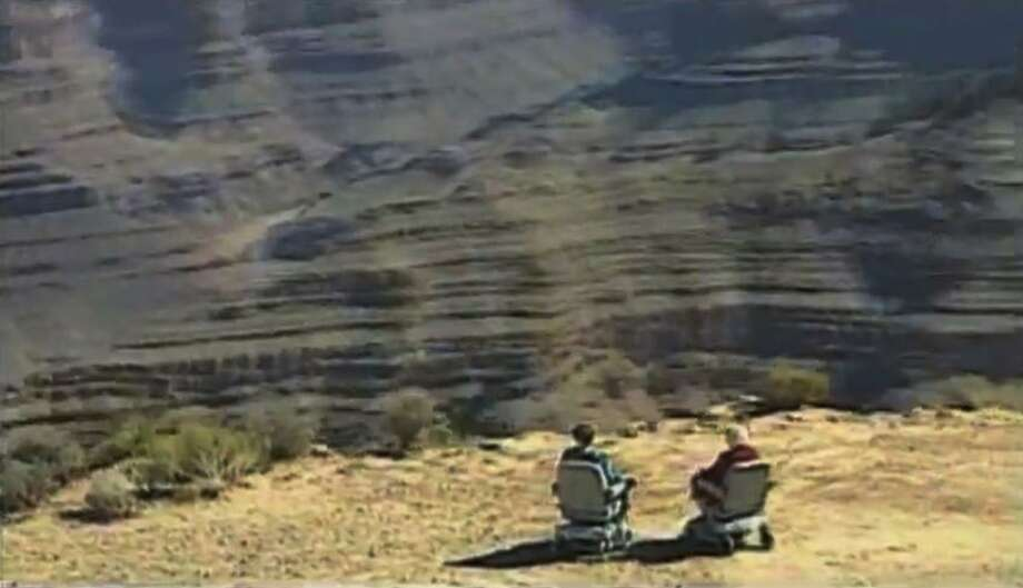 This undated screenshot shows a frame grab from a Hoveround commercial. Members of Congress say the ads by The Scooter Store and Hoveround have lead to hundreds of millions of dollars in unnecessary spending by Medicare, which is only supposed to pay for scooters when seniors are unable to use a cane, walker or regular wheelchair. Government inspectors say up to 80 percent of the scooters and power wheelchairs Medicare buys go to people who don't meet the requirements. And doctors say more than money is at stake: Seniors who use scooters unnecessarily can become sedentary, which can exacerbate obesity and other disorders.(AP Photo/Hoveround) Photo: AP / Hoveround
