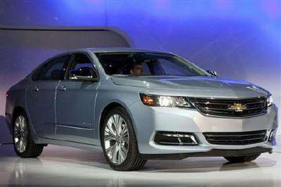 The 2014 Chevy Impala is unveiled during the 2012 New York International Auto Show at the Javits Center in New York, April 4, 2012. (Reuters/Andrew Burton)