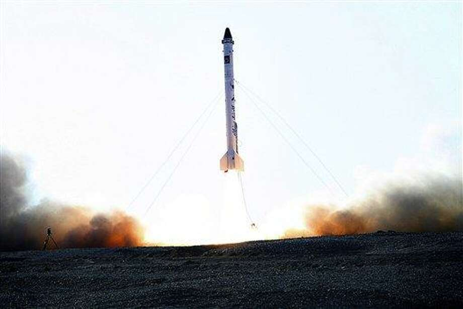 In this picture obtained from the Iranian Students News Agency, ISNA, the rocket dubbed 'Pishgam,' or 'Pioneer' is launched, in an undisclosed location in Iran. A gray-tufted monkey strapped in a pod resembling an infant's car seat rode an Iranian rocket into space and returned safely, officials said Monday, Jan. 28, 2013, in what was described as a step toward Tehran's goal of a manned space flight. (AP Photo/ISNA, Mohammad Agah) Photo: AP / Iranian Students News Agency, ISNA