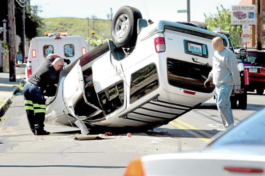 An SUV ended up on its roof after colliding with a car at the intersection of Clover Place and Washington Avenue in New Haven Tuesday. VM Williams — NEW HAVEN REGISTER Photo: Journal Register Co.