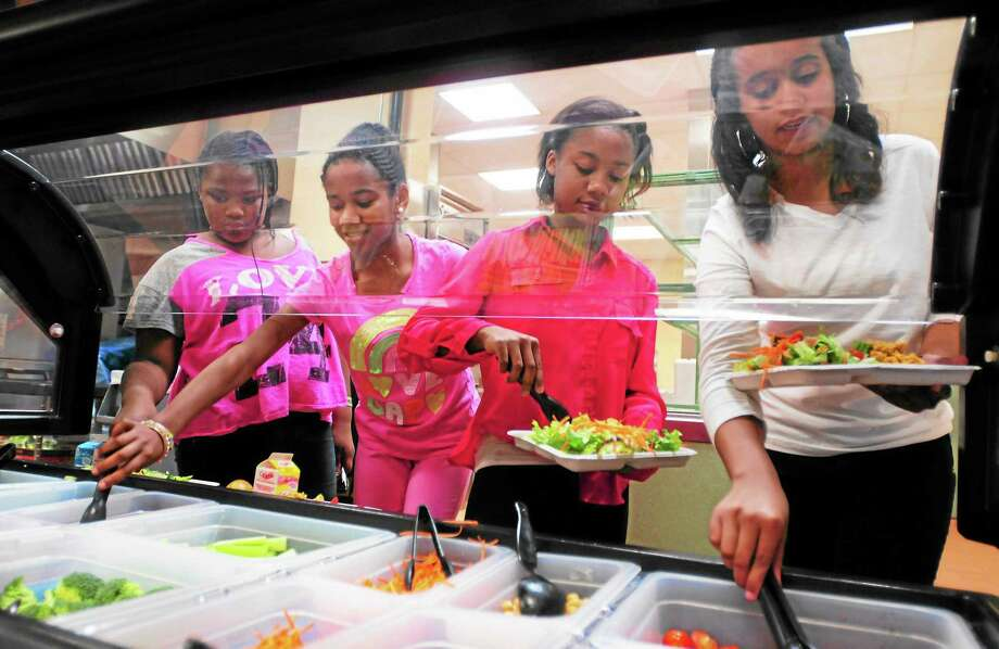 From left, Jepson School sixth-graders Makayla Chambers and Taylor Bagley, with eighth-graders Tiler McPherson and Sayerah Kennedy, at the school cafeteria salad bar during lunch recently. Photo: Peter Hvizdak — New Haven Register         / ©Peter Hvizdak /  New Haven Register