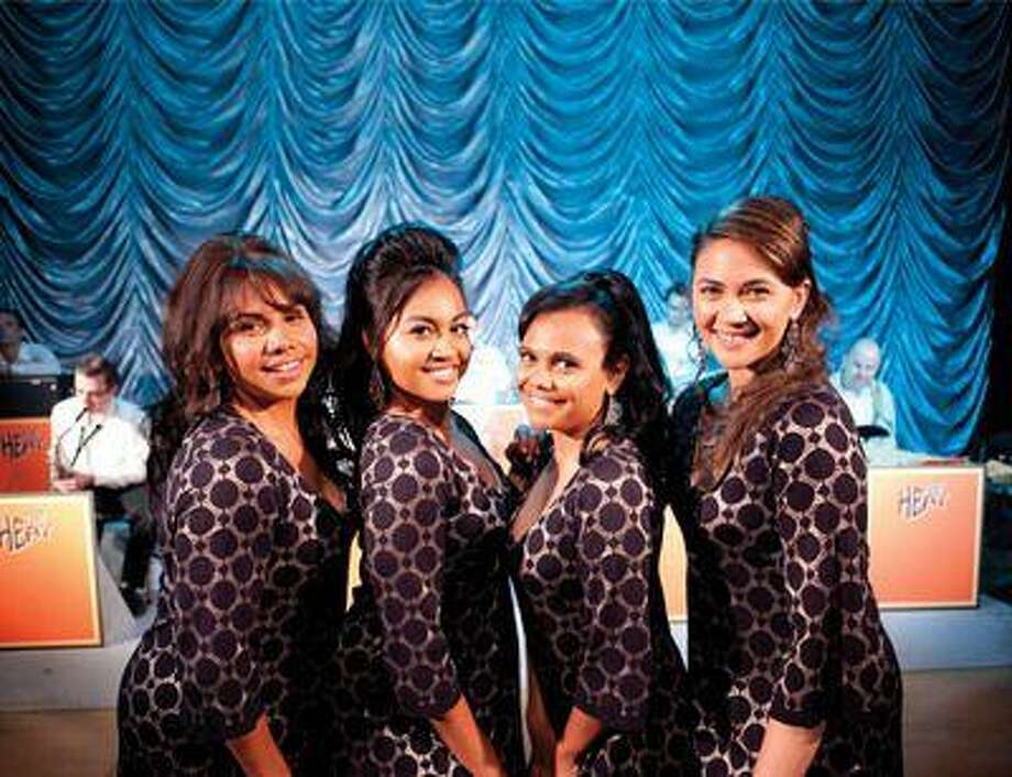 """This film publicity image released by The Weinstein Company shows, from left, Deborah Mailman as Gail, Jessica Mauboy as Julie, Miranda Tapsell as Cynthia, and Shari Sebbens as Kay from """"The Sapphires."""" (AP Photo/The Weinstein Company, Lisa Tomasetti) Photo: AP / The Weinstein Company net"""