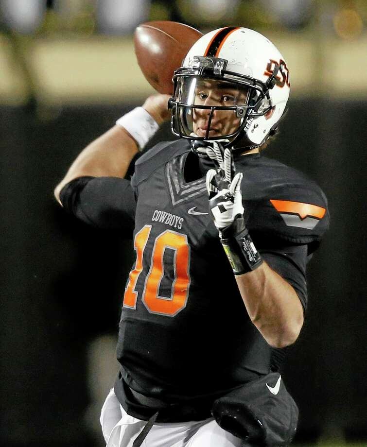 Oklahoma State quarterback Clint Chelf. Photo: Sue Ogrocki — The Associated Press   / AP