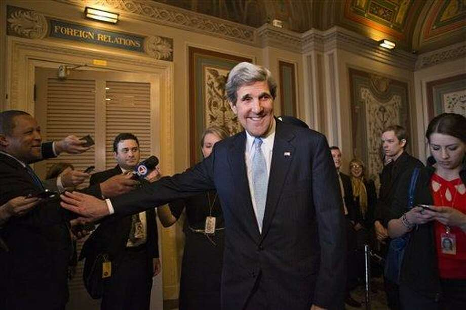 Sen. John Kerry, D-Mass., emerges after a unanimous vote by the Senate Foreign Relations Committee approving him to become America's next top diplomat, replacing Secretary of State Hillary Rodham Clinton, on Capitol Hill in Washington, Tuesday, Jan. 29, 2013. Kerry, who has served on the Foreign Relations panel for 28 years and led the committee for the past four, is expected to be swiftly confirmed by the whole Senate later Tuesday.   (AP Photo/J. Scott Applewhite) Photo: AP / AP