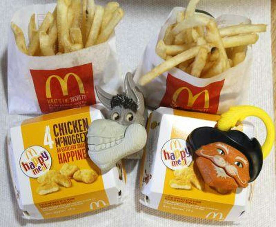 "Two McDonald's Happy Meals with toy watches fashioned after the characters Donkey and Puss in Boots from the movie ""Shrek Forever After"" are pictured in Los Angeles June 22, 2010. Photo: REUTERS / X90045"
