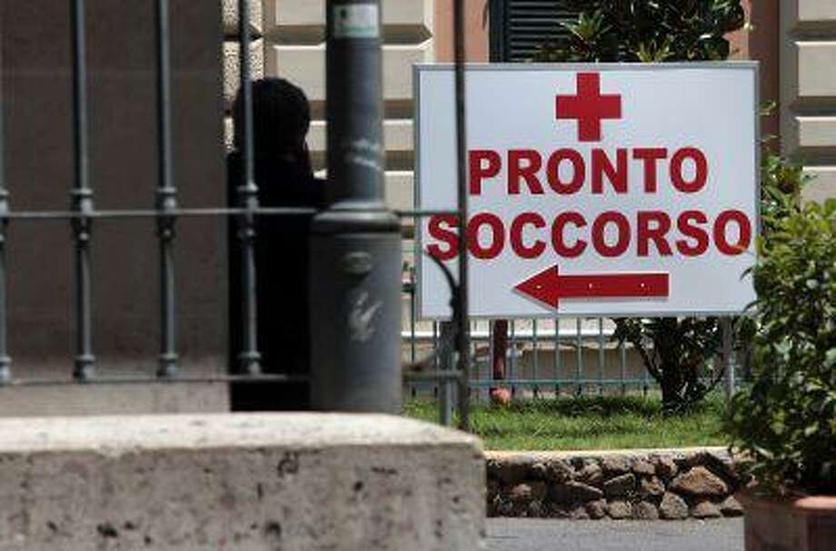 A sign points towards the Emergency Department at Policlinico Umberto I hospital in Rome, Italy. The most popular overseas destinations for Americans last year included Europe, the Caribbean and Asia, which together accounted for nearly 80 percent of all trips outside North America. Photo: Getty Images / 2013 Getty Images