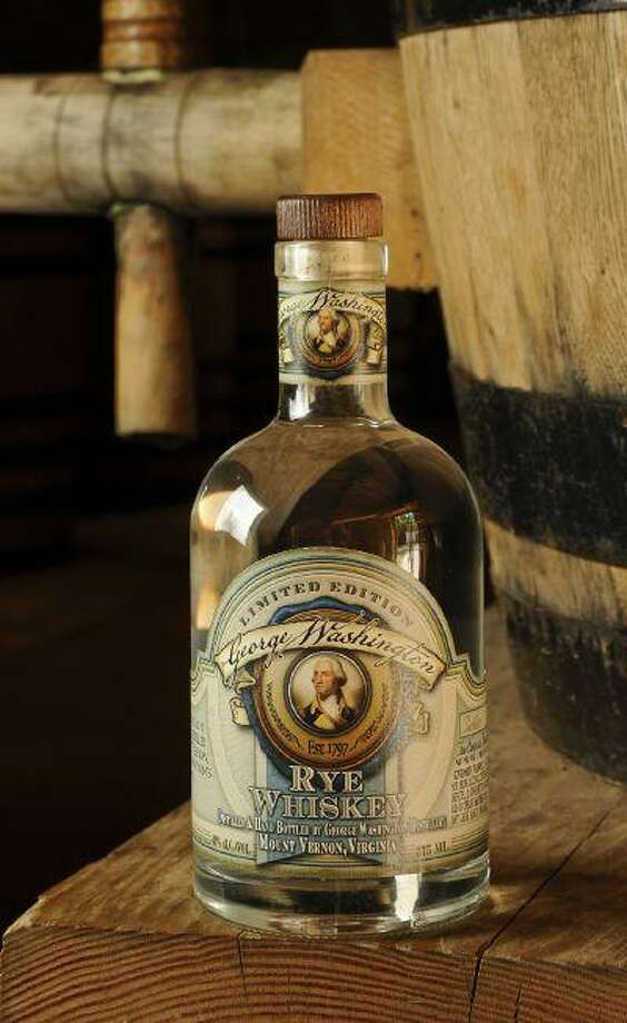 Starting April 4, the George Washington Distillery plans to sell 1,100 bottles of whiskey made according to Washington's recipe and original techniques. The whiskey, made from water nearby and locally grown grain, will cost $95 a bottle at the gift shop of Washington's main estate in Mount Vernon, Va., and at the distillery and gristmill. Photo: Russ Flint / Russ Flint