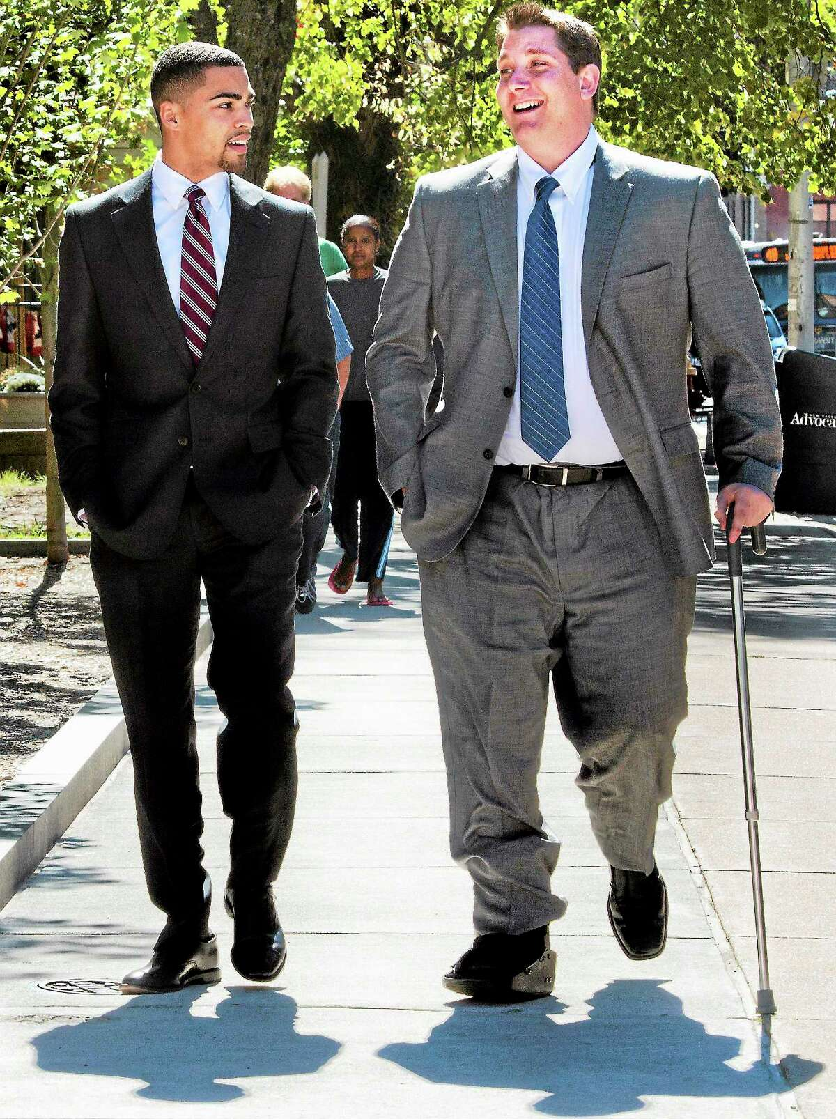 (Melanie Stengel — New Haven Register ) East Haven Police Officer, David Cari (R), and his lawyer, leave U.S. District Court in Hartford for a lunch break 9/23.
