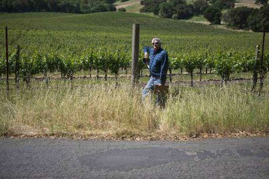Craig Harrison., founder of SOS Roads, poses by a pothole littered road in Sonoma County, California, May 9, 2013. (Beck Diefenbach/Reuters) Photo: REUTERS / X02805