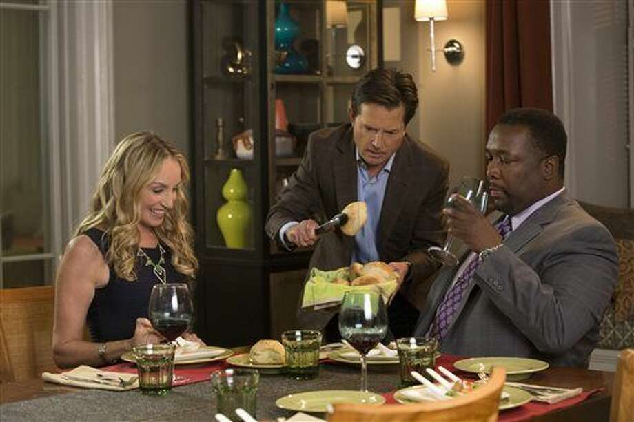 """This image released by NBC shows, from left, Tracy Pollan, Michael J. Fox, and Wendell in a scene from """"The Michael J. Fox Show,"""" premiering Thursday at 9 p.m. EDT in a special hour-long edition. (AP Photo/NBC, Eric Liebowitz) (Eric Liebowitz)"""