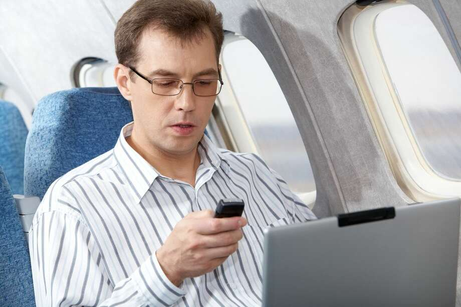 U.S. aviation officials are considering easing restrictions on the use of personal electronics like smartphones, laptop computers and e-readers aboard airplanes, a spokesman said Monday. Photo: Shutterstock.com