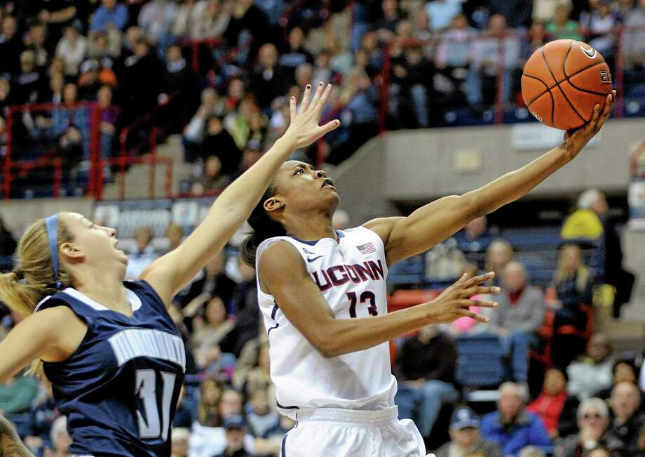UConn's Brianna Banks (13) drives past Monmouth's Jenny Horvatinovic during the first half of the top-ranked Huskies' 100-46 win on Saturday at Gampel Pavilion in Storrs. Photo: Fred Beckham — The Associated Press   / FR153656 AP