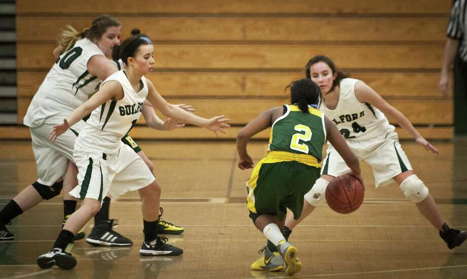Hamden's  Alivia Wilson has her path blocked by Guilford's Presley Altieri, left and Ali Hart. Back left is Kylie Craig.  Both Hamden and Guilford had its games Monday against West Haven and Law, respectively, postponed to Tuesday. Photo by  Melanie Stengel.