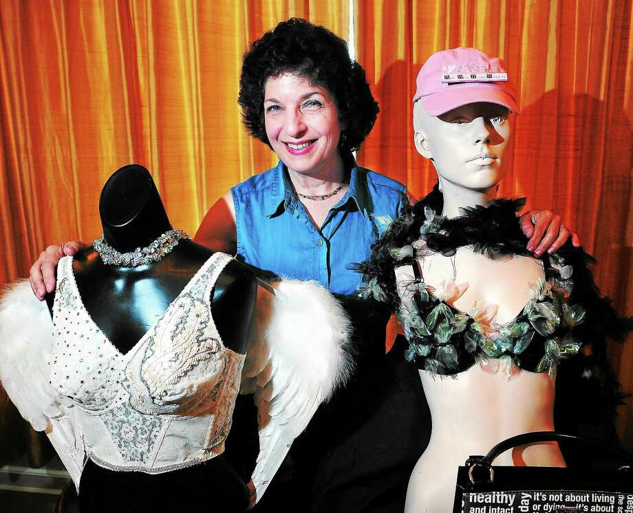 Gaye Hyre poses at her New Haven home with two of the bras that will be part of the ArtBra New Haven Live Runway Auction. Photo: Arnold Gold — New Haven Register