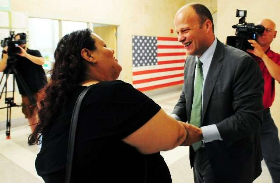 Garth Harries, newly appointed City of New Haven Superintendent of Schools, right,  is congratulated by East Rock School PTO President and  Citywide Parent Leadership Team member Daisy Y. Gonzales Thursday July 25, 2013 at the Fair Haven School in New Haven. Peter Hvizdak/New Haven Register Photo: New Haven Register / ©Peter Hvizdak /  New Haven Register