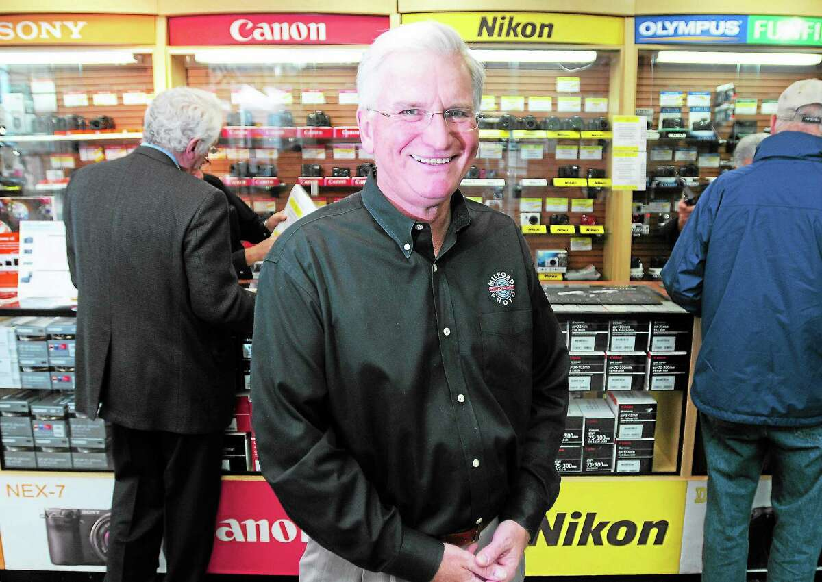 (Arnold Gold — New Haven Register) Jim Wilson, owner of Milford Photo, is photographed in the store in downtown Milford on 11/22/2013.