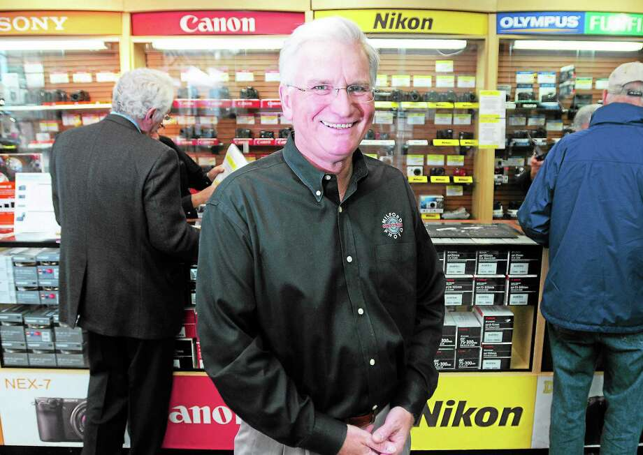 (Arnold Gold — New Haven Register)  Jim Wilson, owner of Milford Photo, is photographed in the store in downtown Milford on 11/22/2013. Photo: Journal Register Co.
