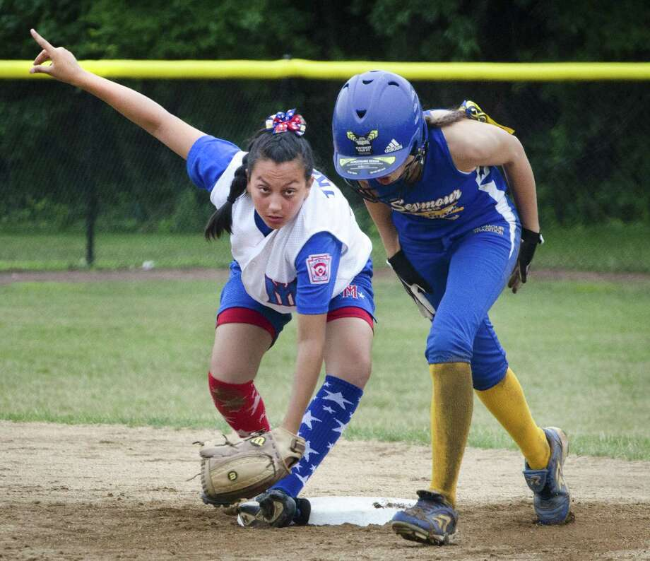 Staten Island's shortstop Nicole Trani points after tagging out Seymour's Rebecca Johnson in the 5th inning Thursday. (Melanie Stengel -- Register)