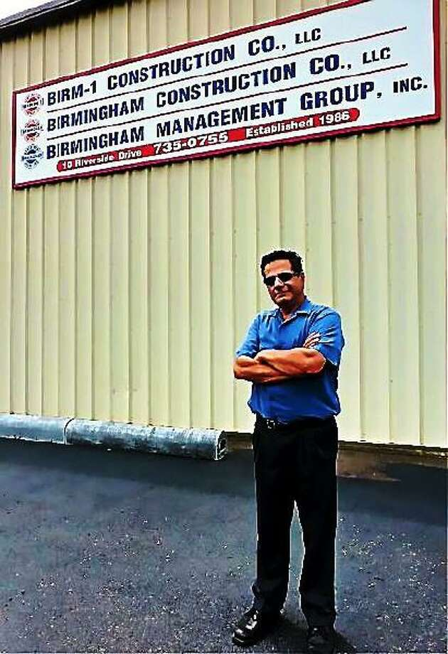 David S. Cassetti, Republican candidate for mayor of Ansonia, outside his construction business. Patricia Villers/Register