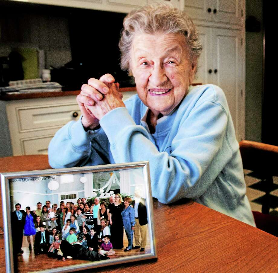 Louise Bonito, 100, of North Haven with a photo of her family. Photo: Melanie Stengel — New Haven Register