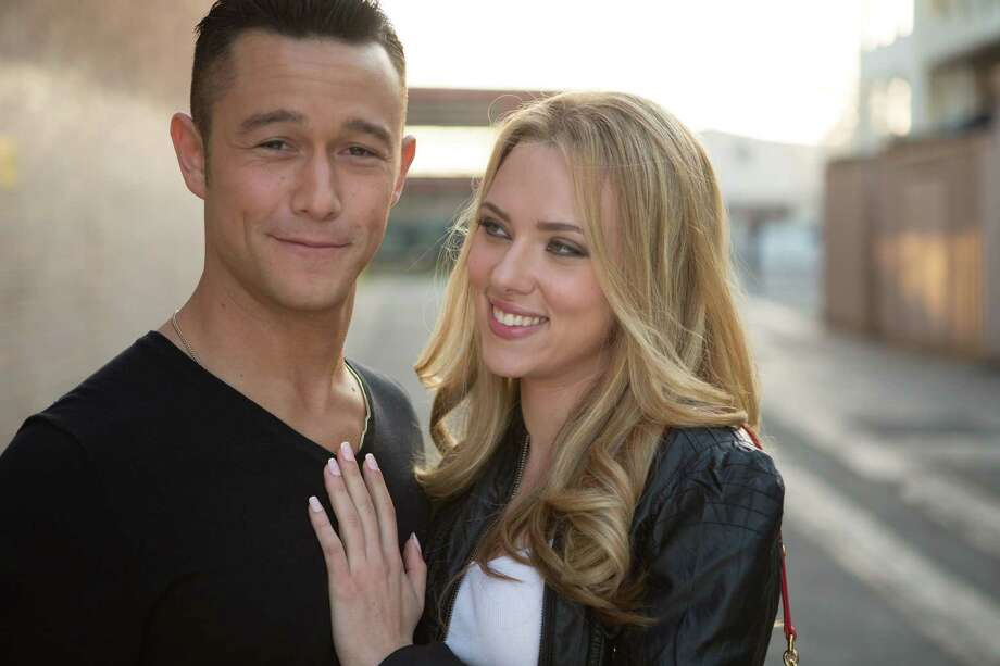 """Writer/director Joseph Gordon-Levitt and Scarlett Johansson star in Relativity Media's """"Don Jon."""" Gordon-Levitt's first foray into feature screenwriting and directing follows a modern-day Don Juan, played by Gordon-Levitt, who frequents bars to pick up women but much prefers the emotion-free pleasures of pornography.  llustrates FILM-GORDONLEVITT (category e), by Stephanie Merry  © 2013, The Washington Post. Moved Monday, Sept. 23, 2013. (MUST CREDIT: Daniel McFadden/ Relativity Media) Photo: Relativity Media / THE WASHINGTON POST"""
