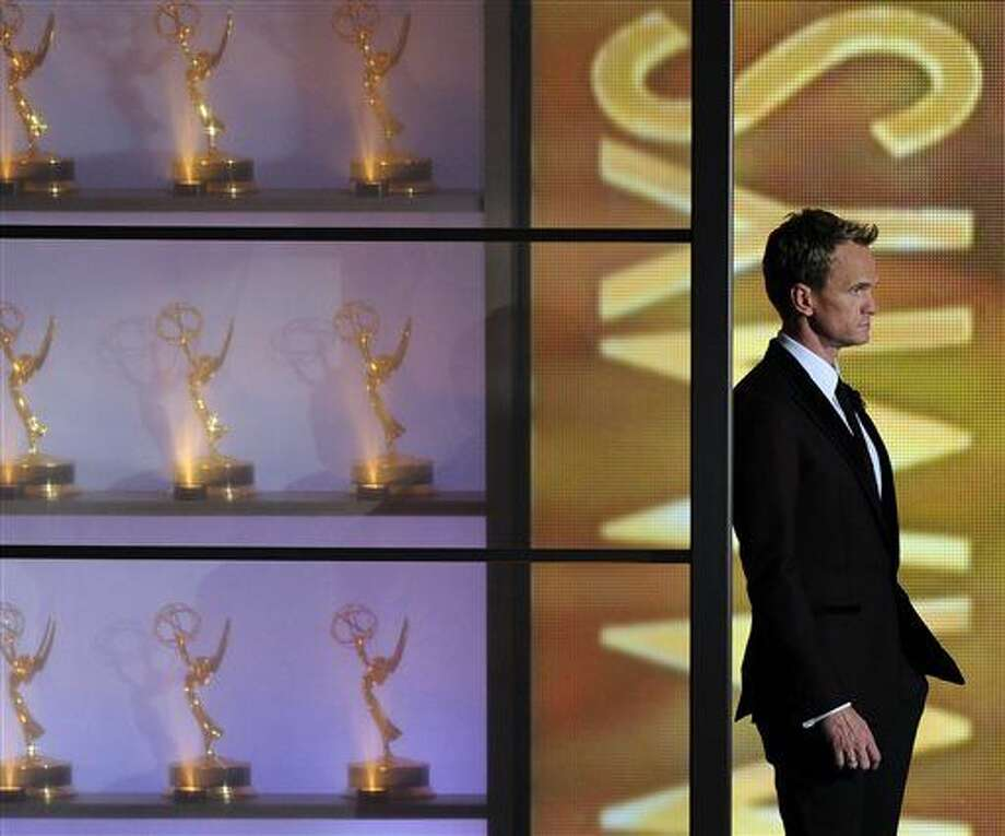 Host Neil Patrick Harris appears on stage at the 65th Primetime Emmy Awards at Nokia Theatre on Sunday Sept. 22, 2013, in Los Angeles.  (Photo by Chris Pizzello/Invision/AP) (Chris Pizzello)
