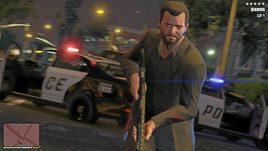 """This publicity photo released by Rockstar Games shows a screen shot from the video game, """"Grand Theft Auto V."""" (AP Photo/Rockstar Games) Photo: AP / Rockstar Games"""