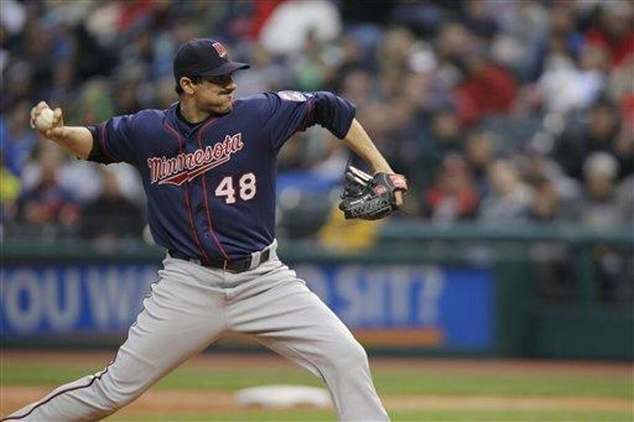 Minnesota Twins starting pitcher Carl Pavano delivers against the Cleveland Indians in a baseball game Friday, June 1, 2012, in Cleveland. (AP Photo/Mark Duncan) Photo: ASSOCIATED PRESS / AP2012