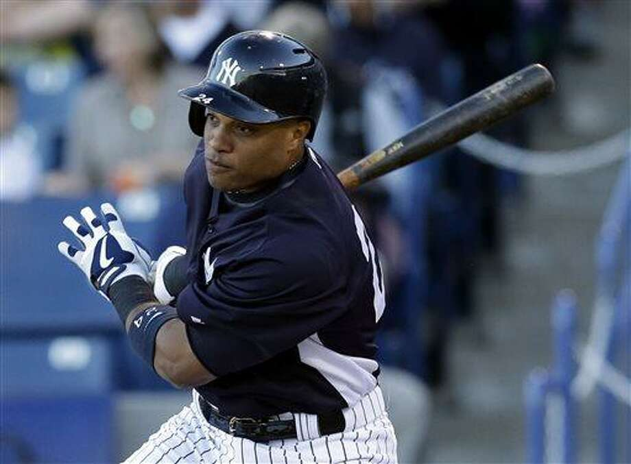 FILE - In this March 21, 2013, file photo, New York Yankees Robinson Cano bats during a spring training baseball game in Tampa, Fla. Now that Alex Rodriguez, Mark Teixeira, Curtis Granderson and Derek Jeter are out of the lineup, Cano is the man on the Yankees.  (AP Photo/Kathy Willens, File) Photo: ASSOCIATED PRESS / AP2013