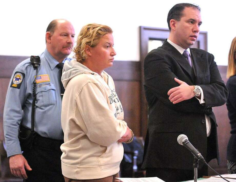New Haven-- Tamara Sytch with her attorney, Rob Serafinowicz, at her arraignment for violation of a protective order. Photo-Peter Casolino 1/28/13