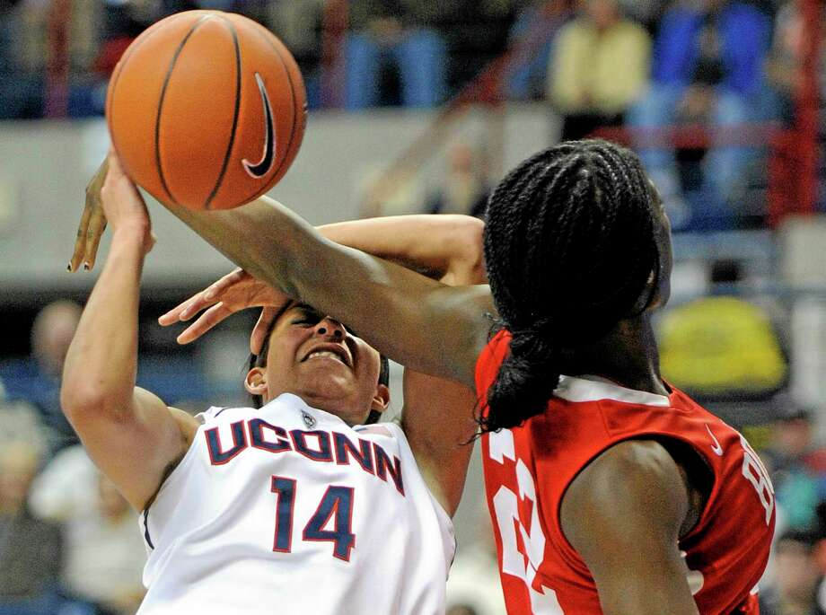 UConn's Bria Hartley (14) is fouled by Boston University's Rashidat Agboola in Friday's game. Photo: Fred Beckham — The Associated Press   / FR153656 AP