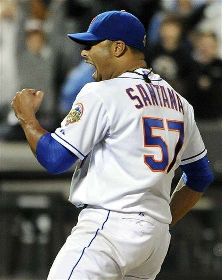 FILE - In this June 1, 2012, file photo, New York Mets starting pitcher Johan Santana celebrates after throwing a no-hitter against the St. Louis Cardinals in a baseball game at Citi Field in New York. The Mets say Santana has injured his left shoulder again and likely will need surgery and miss the 2013 season. (AP Photo/Kathy Kmonicek, File) Photo: ASSOCIATED PRESS / AP2012