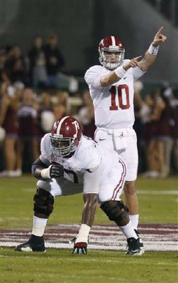 Alabama quarterback AJ McCarron (10) directs his team against Mississippi State during the first half of a game Saturday in Starkville, Miss. Alabama won 20-7. Photo: AP / AP