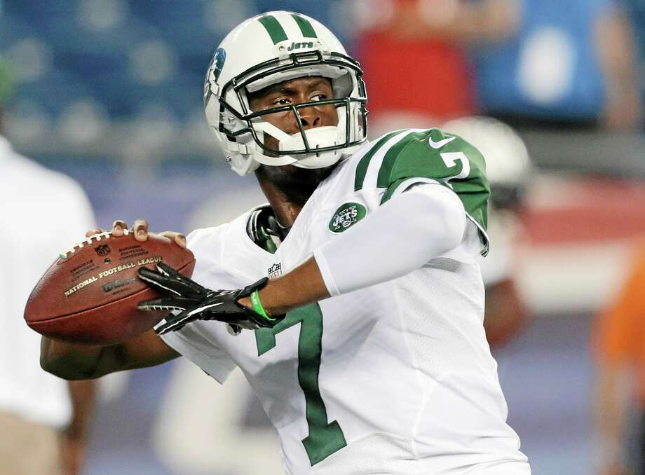 Geno Smith won't be the only rookie quarterback starting Sunday as the Bills will have EJ Manuel at the helm. Photo: Charles Krupa — The Associated Press   / AP