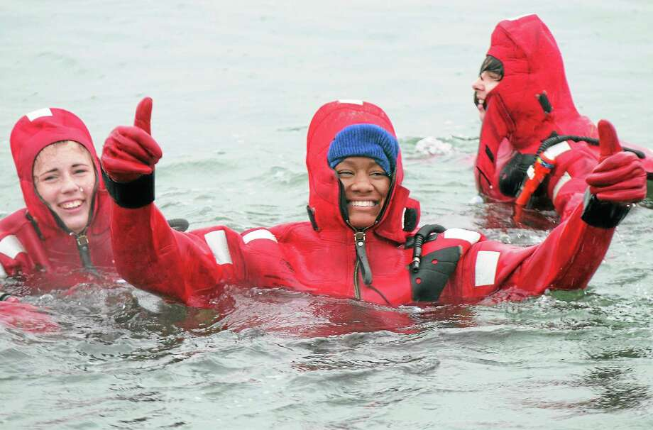 Students at the Sound School tread water as they practice cold water survival training in the New Haven Harbor Friday. Photo: Peter Hvizdak — New Haven Register        / ©Peter Hvizdak /  New Haven Register