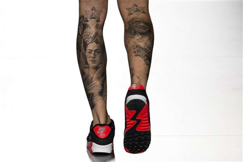 A model's tattoos seen during the Spring/Summer  Dolores Cortes show,  during Madrid's Fashion Week, in Madrid, Spain, Monday, Sept. 16, 2013 . (AP Photo/Daniel Ochoa de Olza) Photo: AP / AP