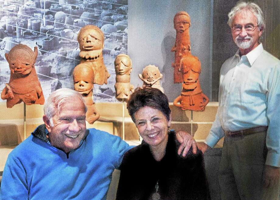 """From left, Joel and SusAnna Grae of New Haven and <a href=""""http://artgallery.yale.edu/african-art"""">Frederick John Lamp,</a> the Frances and Benjamin Benenson Foundation curator of African Art, are seen in front of a portion of the collection of African art donated by the Graes at the Yale University Art Gallery. Some pieces date back 3,000 years. The art originally was collected by civil rights activist, Baynard Rustin, honored posthumously this week at the White House with a Presidential Medal of Freedom. Photo: Melanie Stengel — New Haven Register"""