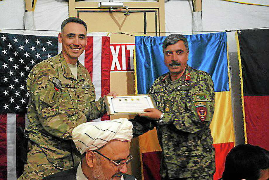Lt. Col. Eric Lopez and his Afghan counterpart, Brigadier Gen. Akram. Photo: Journal Register Co.