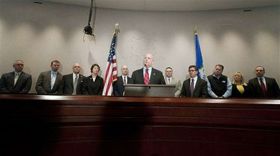 Lawrence G. Keane, senior vice president and general counsel of The National Shooting Sports Foundation Inc., at podium, stands with representatives of Connecticut's gun industry to speak out against attempts to ban certain guns and push for restrictions to prevent people with mental problems from obtaining weapons at a news conference at the Legislative Office Building in Hartford, Conn., Monday, Jan. 28, 2013. (AP Photo/Jessica Hill) Photo: AP / FR125654 AP