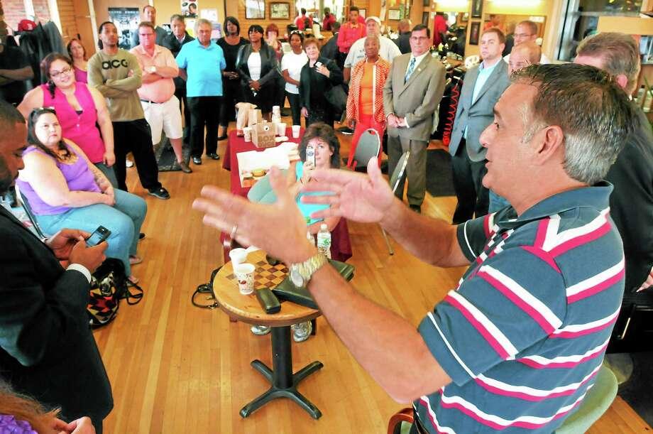 A community conversation with West Haven political candidates including Mayor John Picard, right, drew a crowd at Bladez Barbershop Saturday. Photo: Mara Lavitt — New Haven Register   / Mara Lavitt