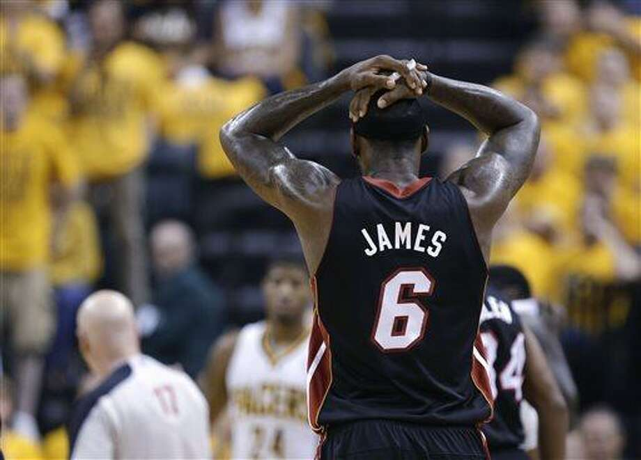 Miami Heat's LeBron James reacts after he was called for a technical foul during the first half against the Indiana Pacers in Game 4 of the NBA basketball Eastern Conference finals, Tuesday, May 28, 2013, in Indianapolis. (AP Photo/Michael Conroy) Photo: AP / AP
