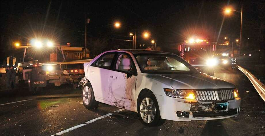 Catherine Avalone/The Middletown Press     A Lincoln MK Z four door sedan collided with a pick up truck in the east bound lane on Route 66 in Portland. The driver of the truck was arrested at the scene. / TheMiddletownPress