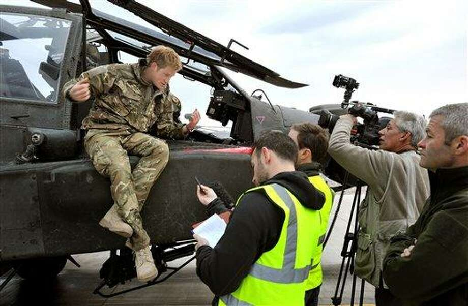 Britain's Prince Harry talks to a TV crew after making his early morning pre-flight checks on the flight line, at Camp Bastion southern Afghanistan. During Prince Harry's 20-week deployment in Afghanistan, he served as an Apache helicopter pilot with the Army Air Corps. AP Photo/John Stillwell Photo: AP / Pool PA