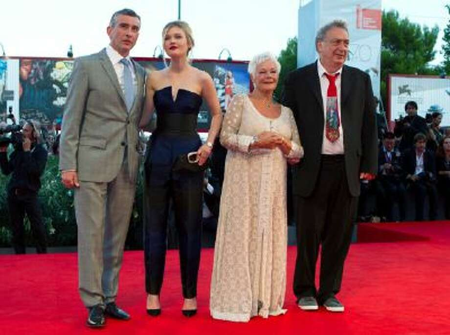 From left, actors Steve Coogan, Sophia Kennedy Clark, and Judi Dench and director Stephen Frears arrive for the screening of the movie ' Philomena' at the 70th edition of the 2013 Venice Film Festival in Venice, Italy.