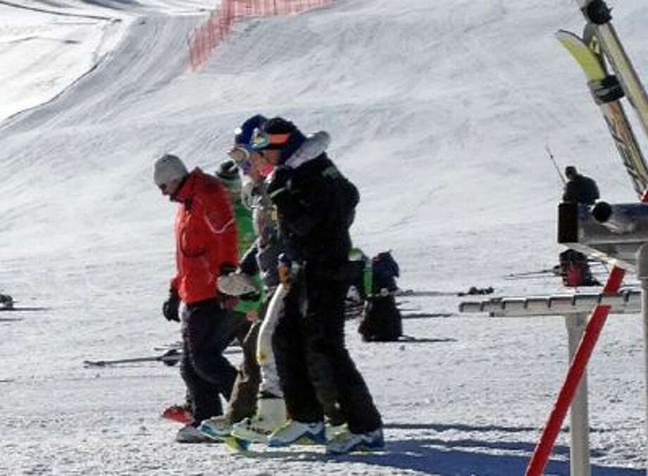 This Tuesday, Nov. 19, 2013, file image provided by Maris Van Slyke, which has been authenticated based on its contents and other AP reporting, reigning Olympic downhill champion Lindsey Vonn, center, is helped off the slope at Copper Mountain, Colo. Vonn crashed while training ahead of her return to racing following knee surgery.
